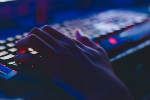 someone typing in a gaming keyboard