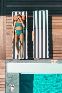woman in her designer swimsuit