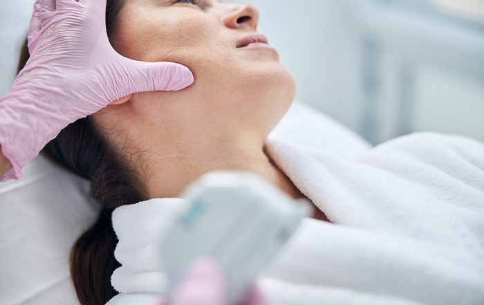 Calm patient being treated by a professional dermatologist