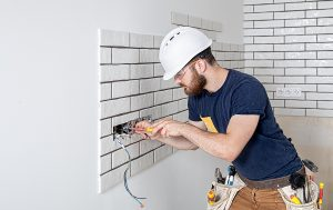 Emergency electrician in Gold Coast checking sockets