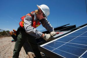 Worker installing commercial solar