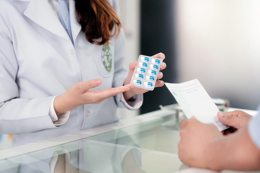 Specialist working in a compounding pharmacy in Melbourne explaining a drug