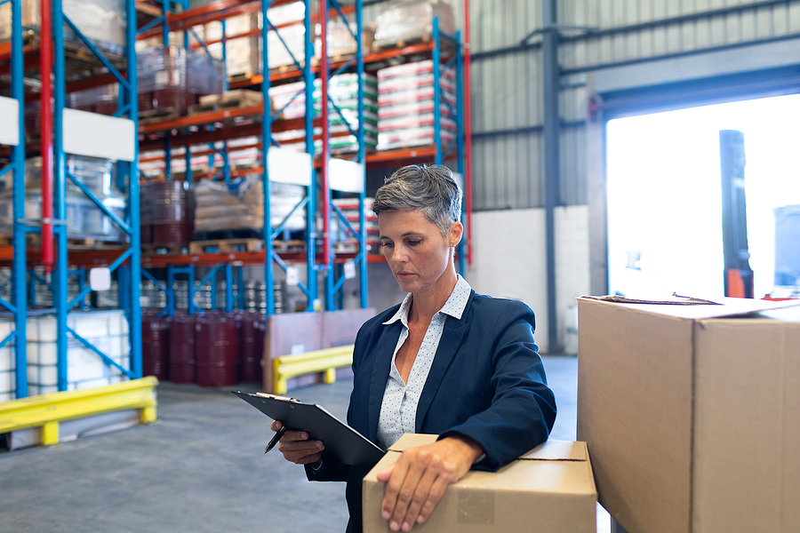 Manager in charge of reverse logistics checking stocks