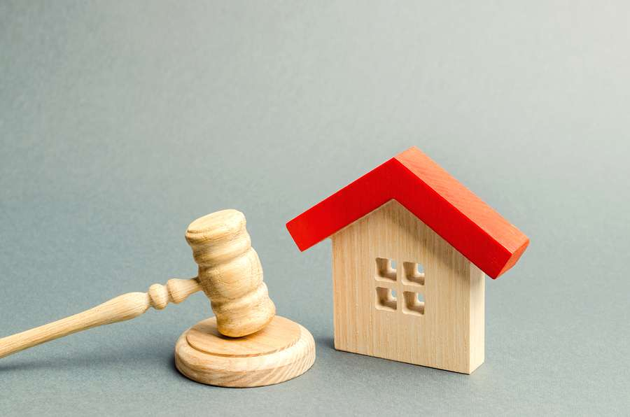 House and a gavel. Conveyancing concept