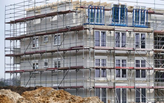 Construction building with scaffold